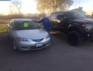 Picking up his Mazda 3!