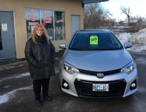 Kathy looking lovely with her 2015 Corolla!