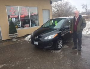 Micheal is taking delivery of his 2011 Mazda!