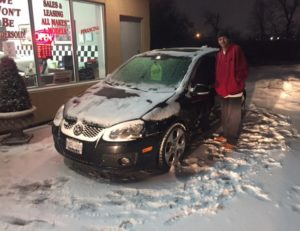 Blair on a snowy day with his 2009 VW GTI!