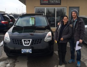Francesca and John picking up her first car in Canada!