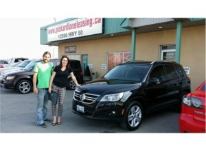 Deborah all smiles with her 2011 Tiguan!