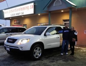 Bruno and Elisa with their sparkly white GMC!