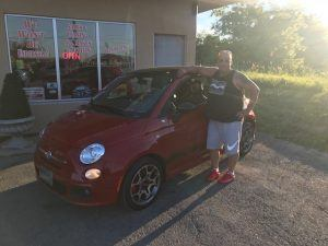 Manny and his red Fiat!
