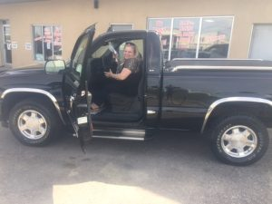Happy Customer and her GMC Sierra.