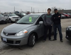 Greg and his son Ryan with Ryans 2012 Versa!