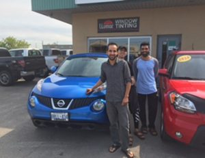 Happy as can be with with his 2011 Nissan Juke!