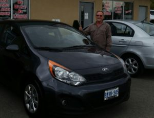 All smiles with his new Kia!