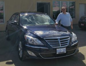 Vince ready to drive away in his new 2013 Genesis!