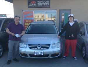 Antonio and his son Dante excited to get there cool new 2009 VW Jetta!