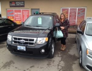 Jennifer ready to go with her 2011 Ford Escape!