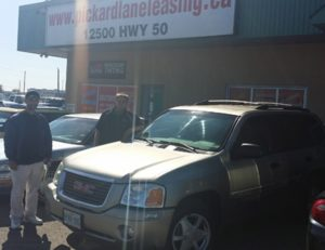 Austin delivering GMC Envoy to Sean!